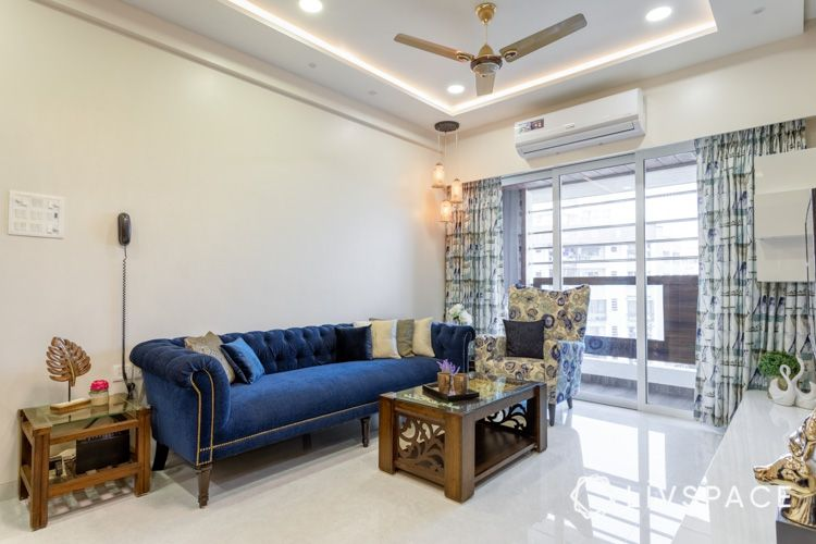 center table buying tips-wooden table-blue sofa-false ceiling