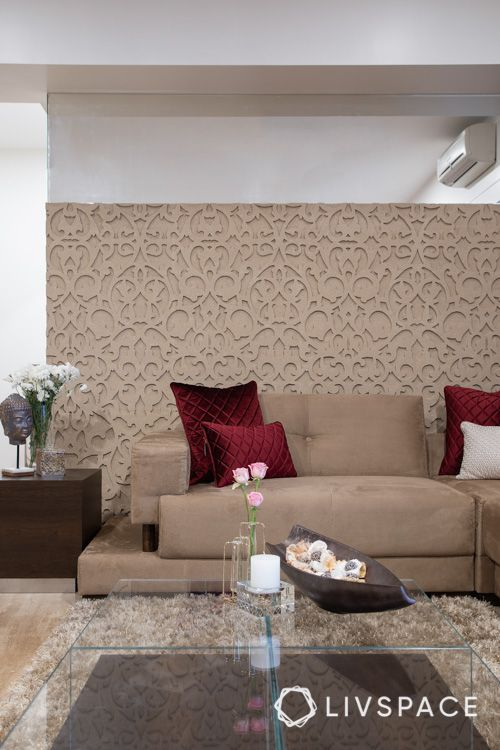 center table buying tips-pop wall-beige wall-red cushions-glass table