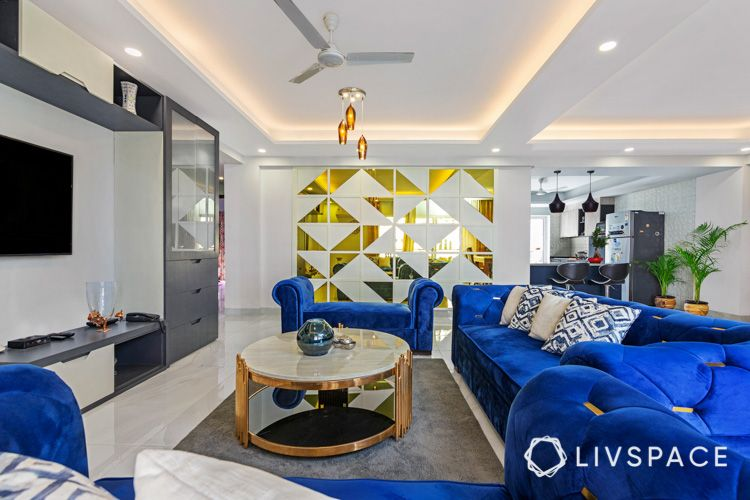 Brass coffee table-mirror feature wall-blue sofa-living room