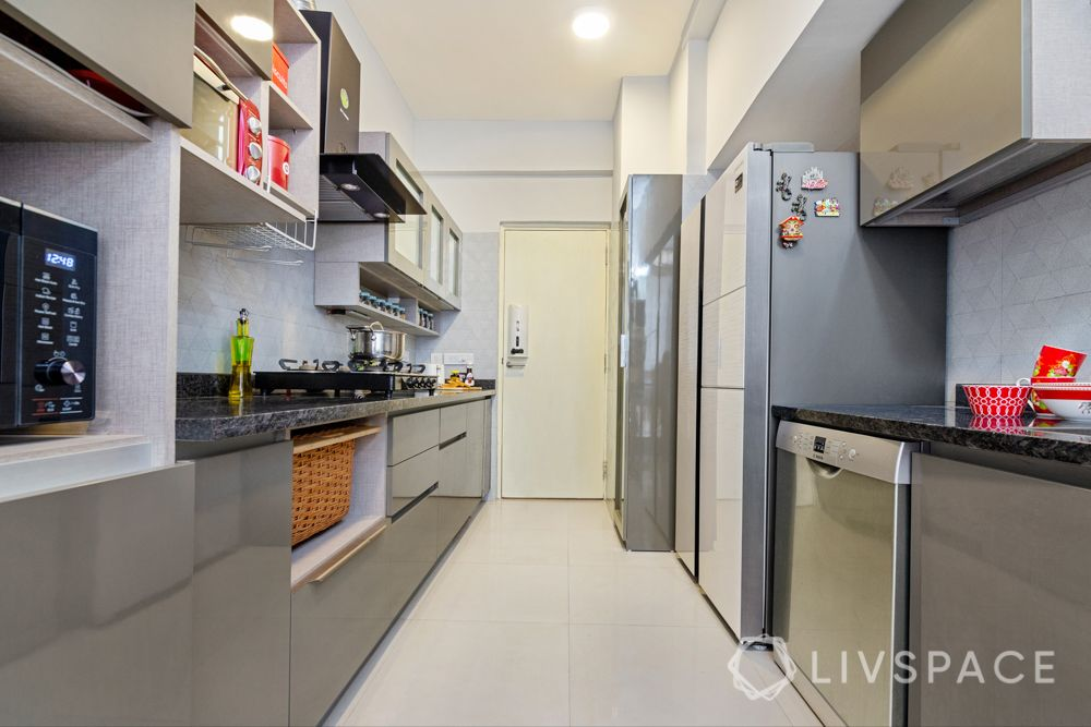 4 BHK flat design-parallel kitchen-wicker basket-laminate finish-frosted glass shutters-open shelves