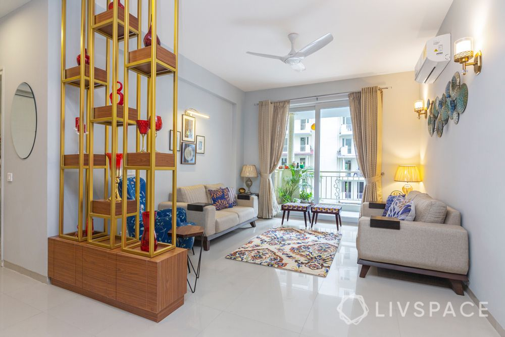 4 BHK flat design-loveseat-cushions-rajasthani paintings-table lamps-upholstered chairs-metal accessories-stools-jali partition