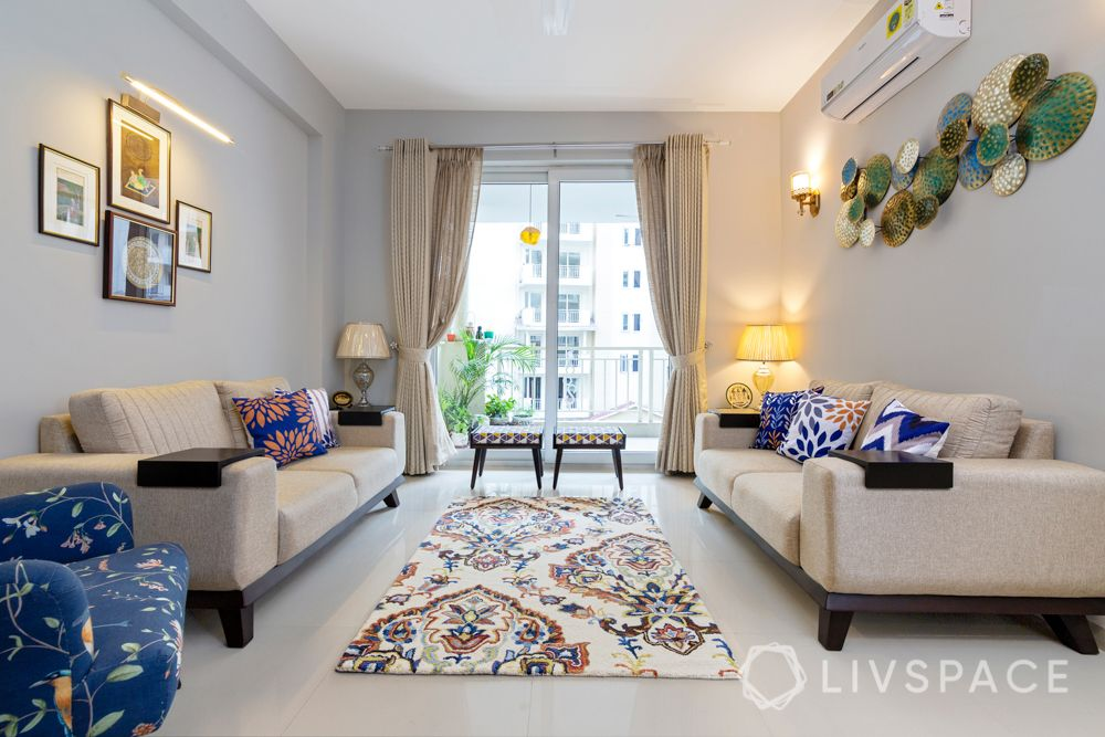 4 BHK flat design-loveseat-cushions-rajasthani paintings-table lamps-upholstered chairs-metal accessories-stools