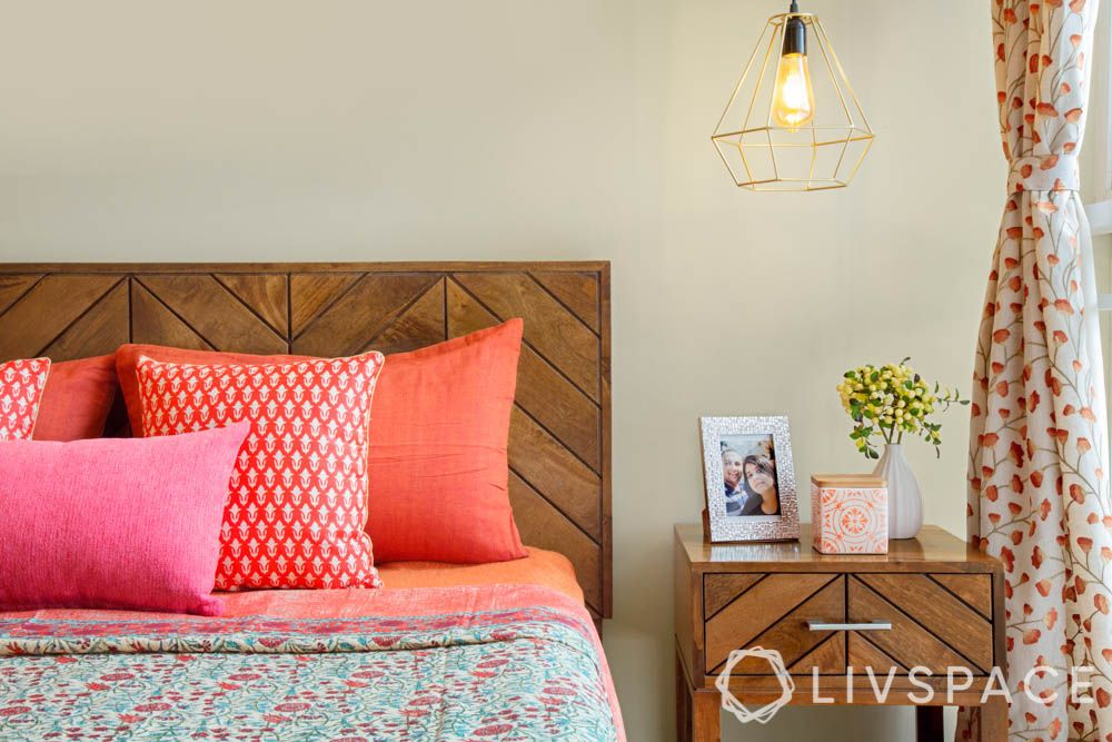 home decorating ideas on a budget-wood bed-side table designs-pink throw pillows