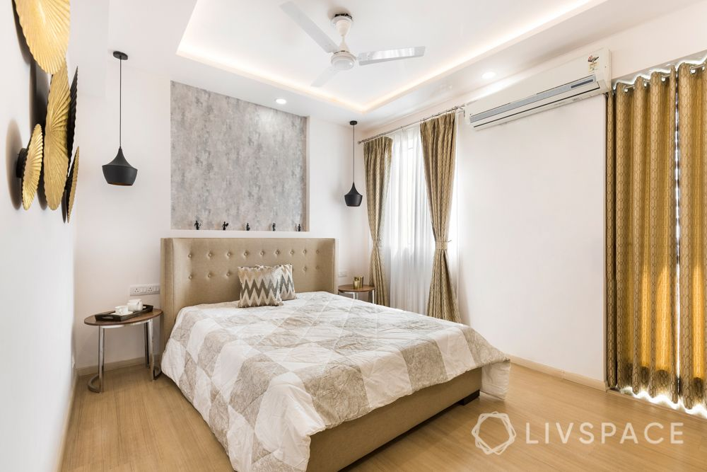 4 BHK in Gurgaon-guest bedroom wallpaper-pendant lights-gold wall accessories