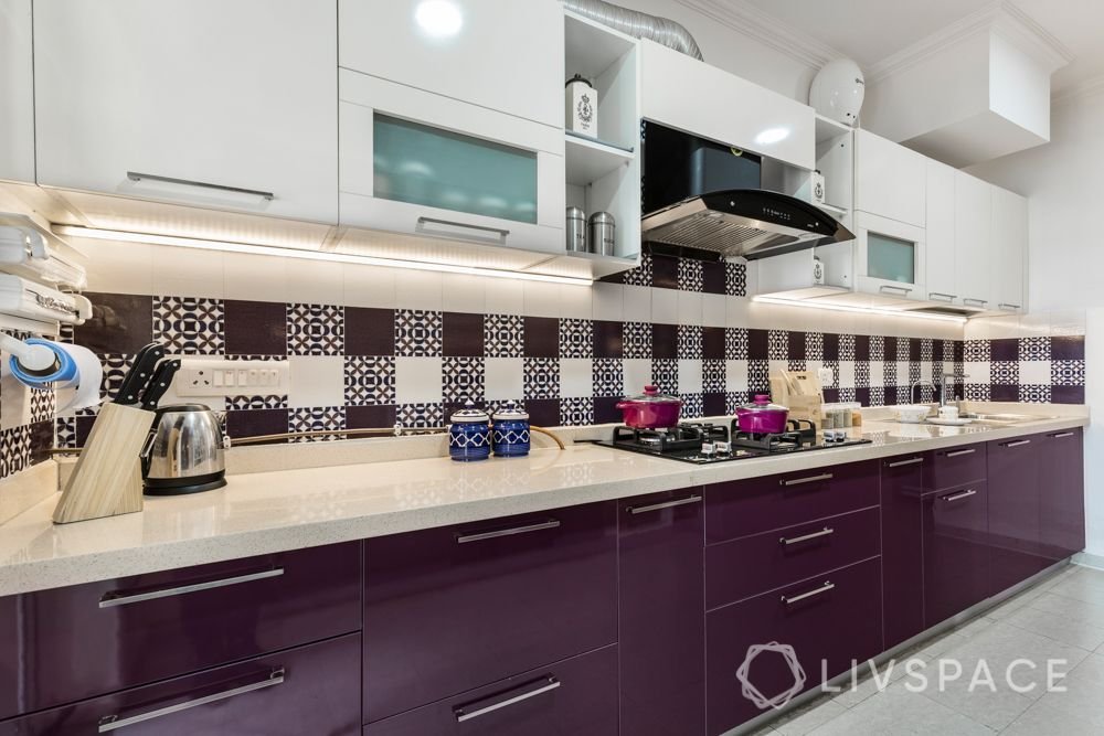 4 bhk in gurgaon-kitchen-patterned tiles-glossy laminate finish-white and purple