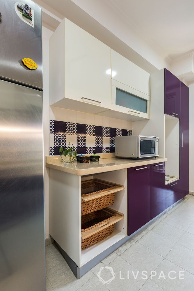 Kitchen tall unit-microwave-wicker baskets-patterned tiles
