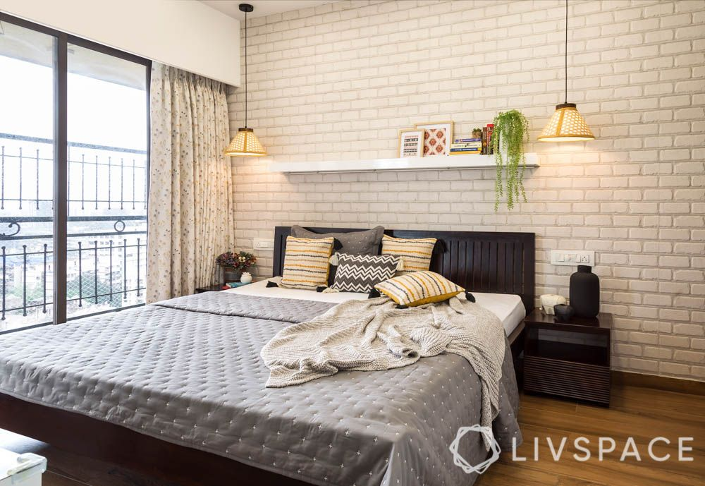 Gender Neutral Bedrooms for Couples-exposed brick wallpaper-display shelf-wooden bed-pendant lights