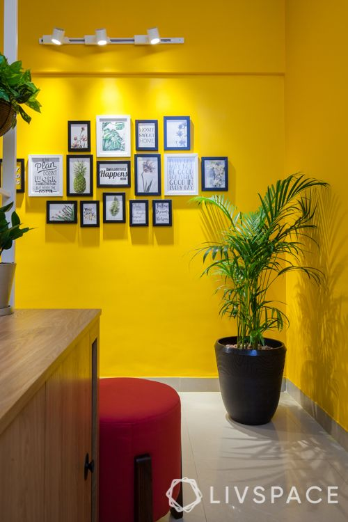 small house interior design-yellow wall-red ottoman-track lights