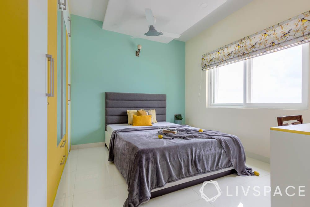 2 BHK in Bangalore-pastel green accent wall-yellow and white wardrobe-grey bed