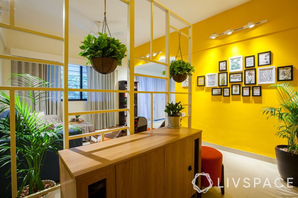 home decor hacks-hanging plants-yellow wall-framed pictures