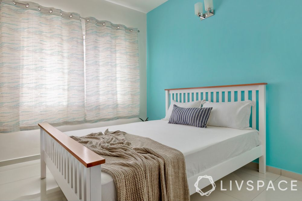 interior design firms in bangalore-turquoise wall-white bed
