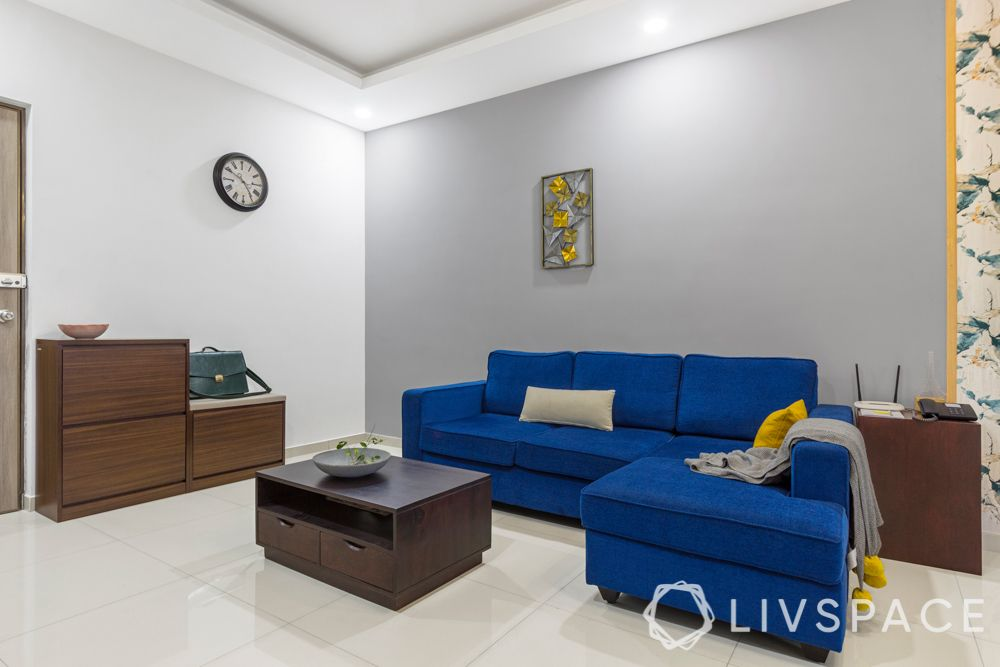 interior design firms in bangalore-blue sofa-grey wall-shoe cabinet-coffee table