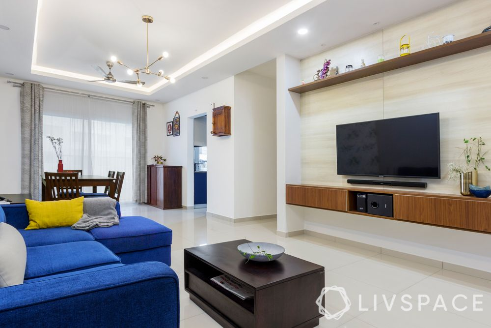 interior design firms in bangalore-blue sofa-grey wall-shoe cabinet-coffee table-tv unit