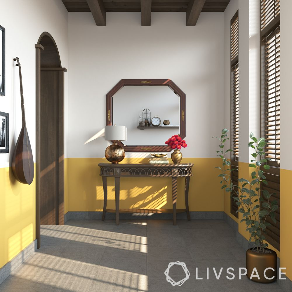 kerala style house-yellow wall colour-wooden console
