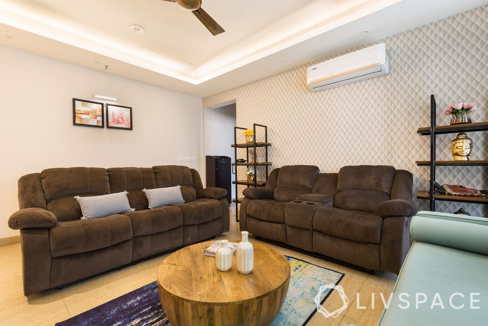 3bhk-flat-design-brown recliners-wallpaper-drum centre table