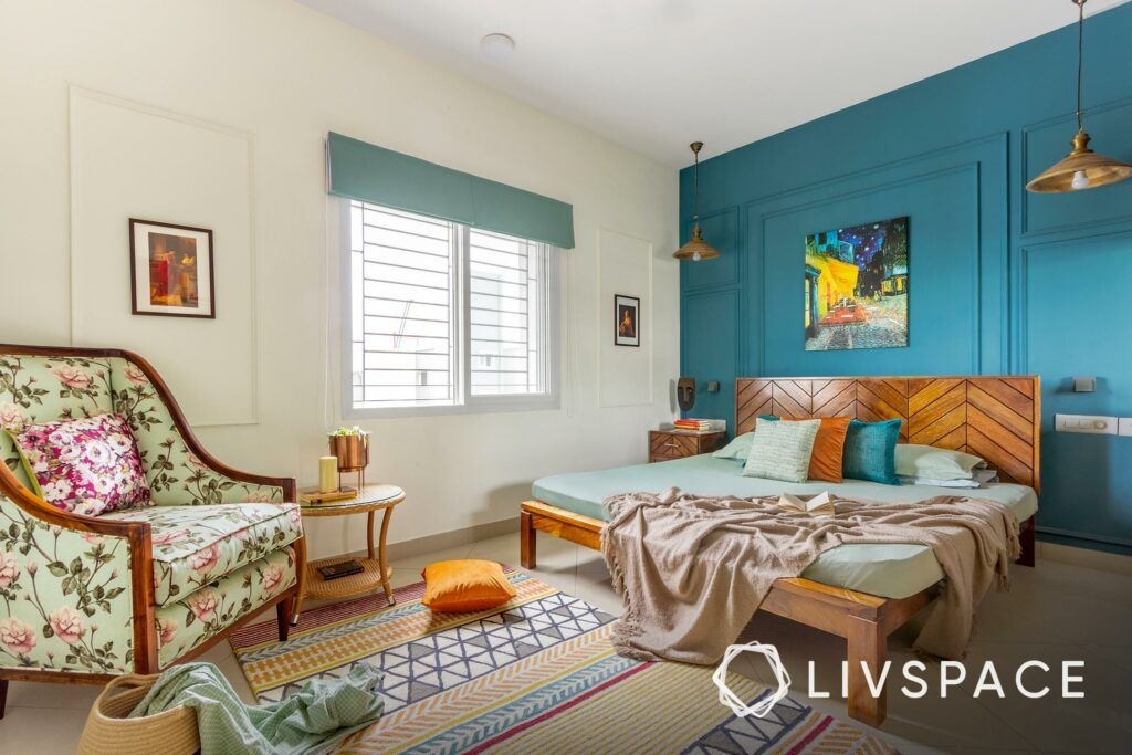 Parents bedroom ideas-bright colours-blue wall-floral accent chair