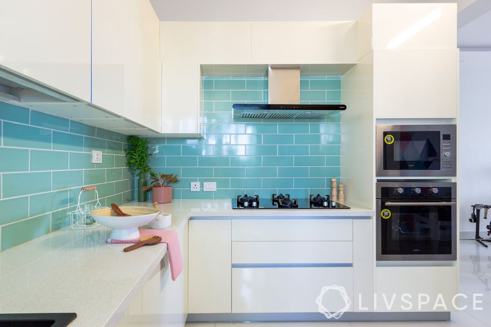 small indian kitchen design in l shape-blue tiled backsplash-white kitchen