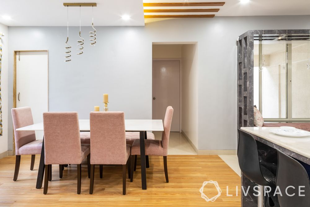 interior designers in pune-pink dining chairs-wooden flooring