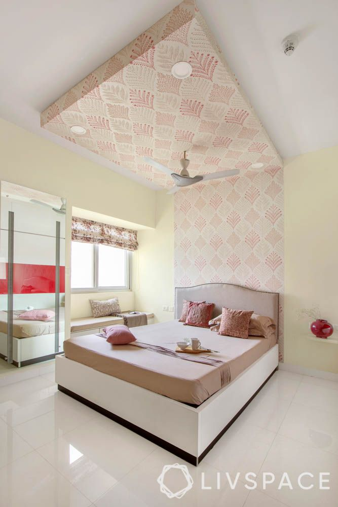 beautiful house design-wall to ceiling headboard-motif designs-beige bed-bay seating