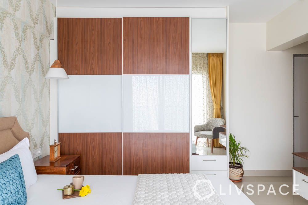 3 bhk in pune-sliding wardrobe-wooden laminate finish