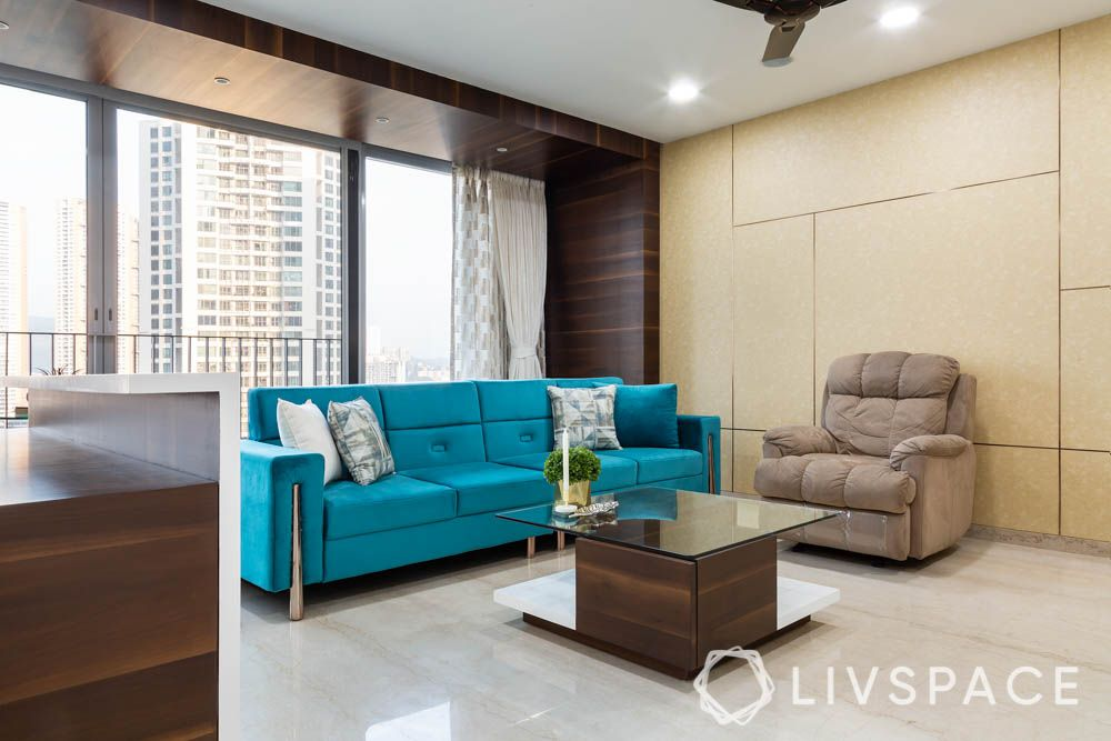 3bhk-house-design-blue-sofa-recliner-wallpaper