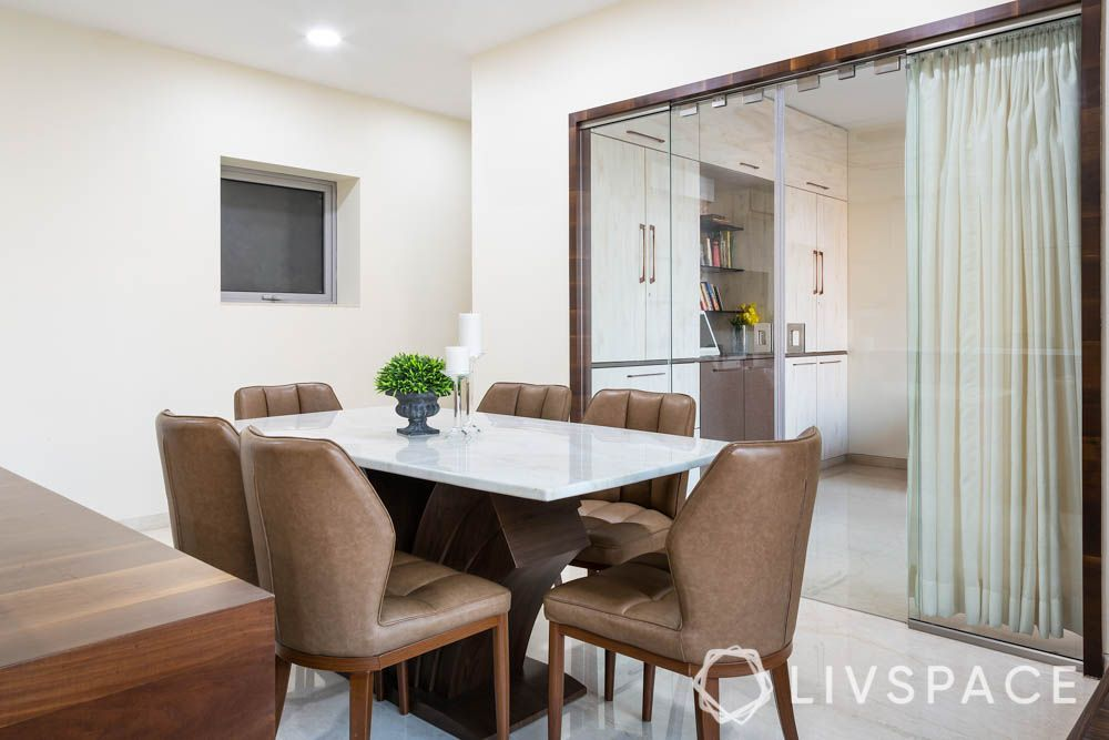 3bhk-house-design-dining-room-glass-door