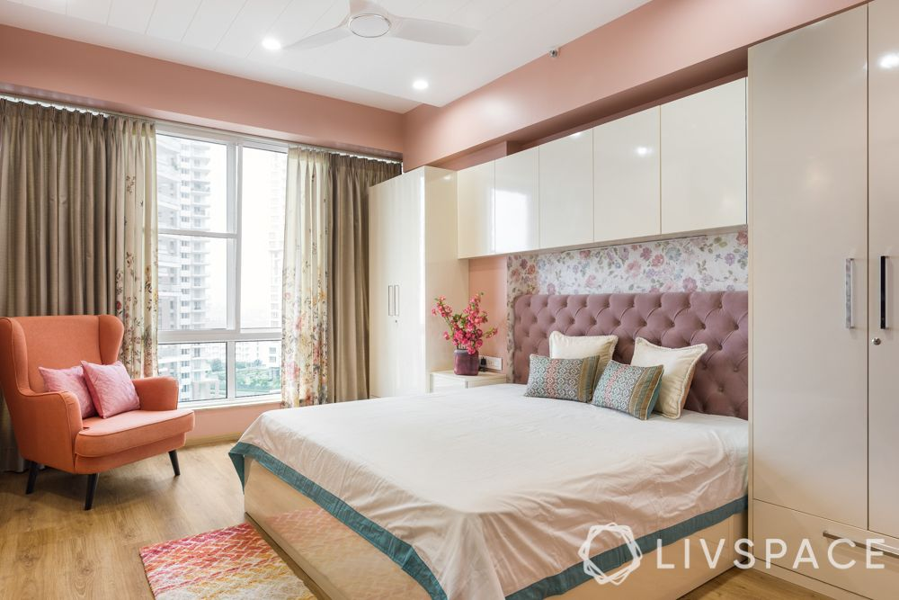vastu shastra tips-master bedroom design-wooden wardrobe-peach wall-floral wallpaper
