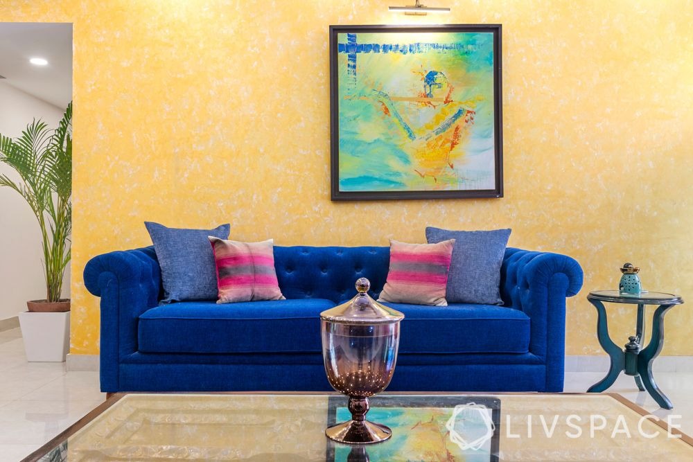 yellow wall-blue couch-living room