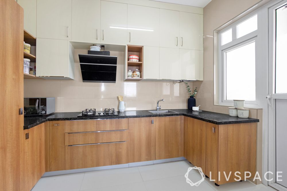 simple interior design-wooden shelves-acrylic cabinets-U shaped kitchen-tall unit