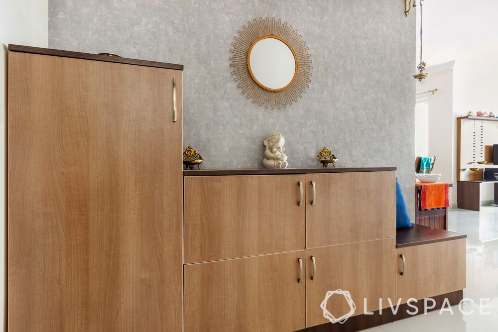 simple interior design-wooden shoe cabinet-brass lamps-mirror designs-sunburst mirror-grey wallpaper