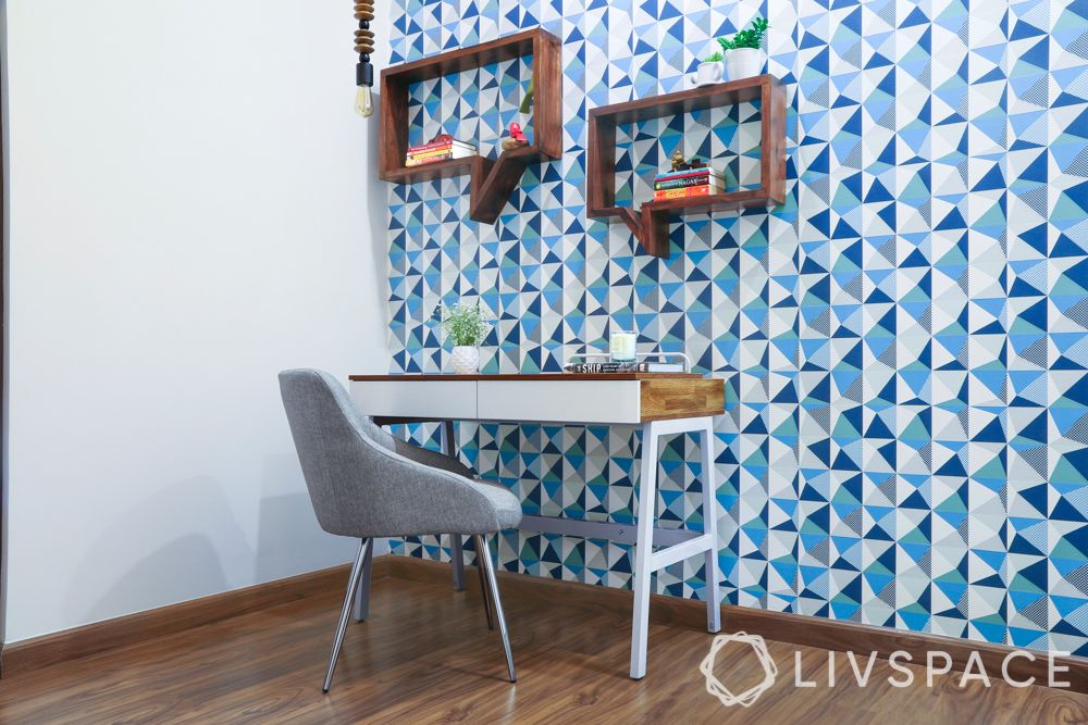 home office ideas-blue pattern wallpaper-floating quote box shelf-study unit-grey chair