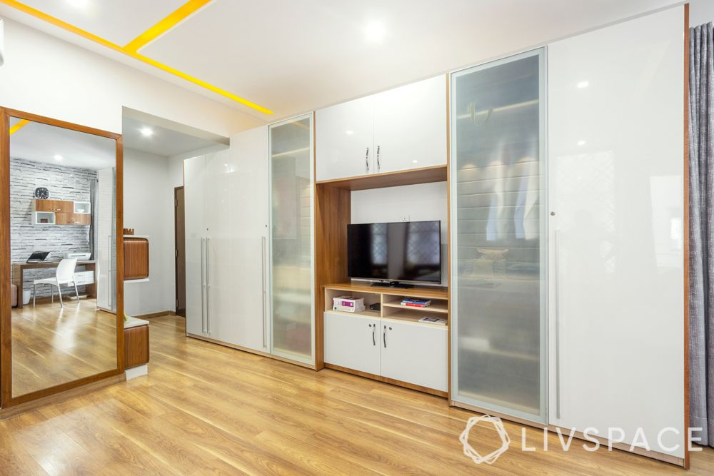 frosted glass-white wardrobe-tv unit-wooden flooring