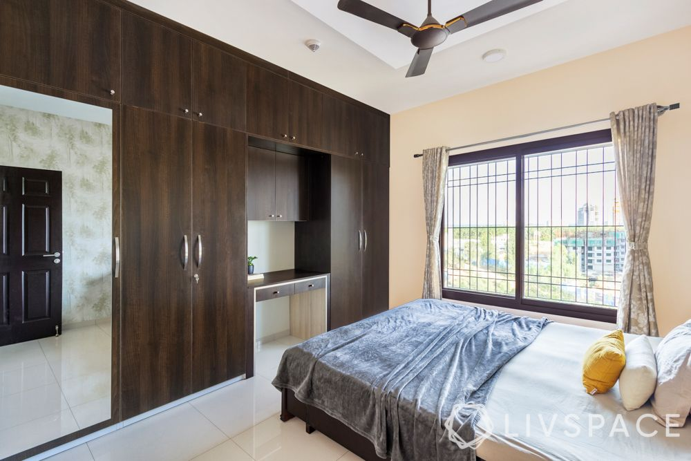 best interiors in bangalore-tile flooring-wooden laminate wardrobe-study unit