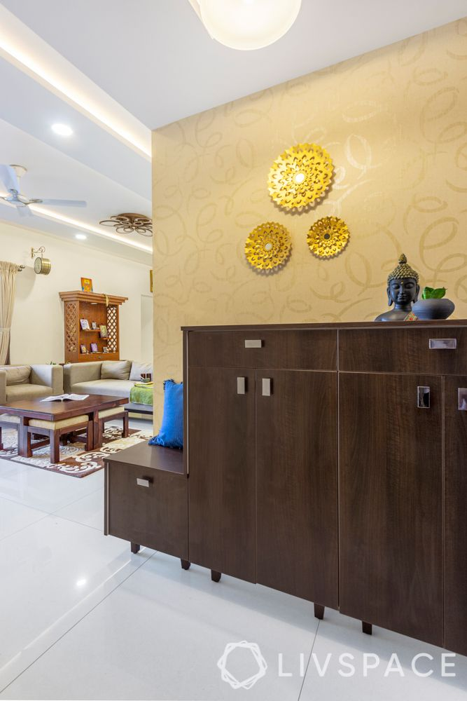 best interiors in bangalore-foyer-shoe cabinet-gold wallpaper-gold wall mount
