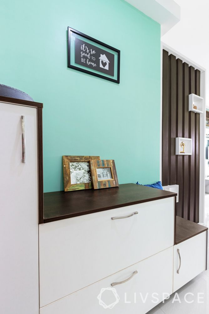 3 bhk flat design-blue wall ideas-white shoe cabinet