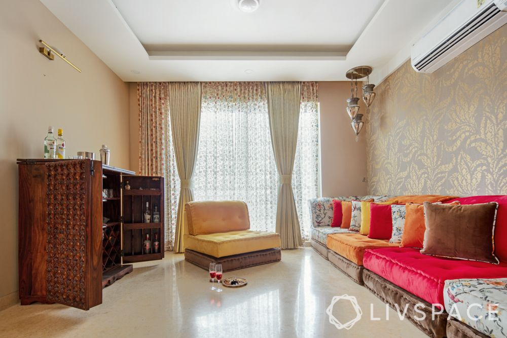 travel-themed interior design-red and yellow seating-wooden bar unit-lanterns-gold wallpaper
