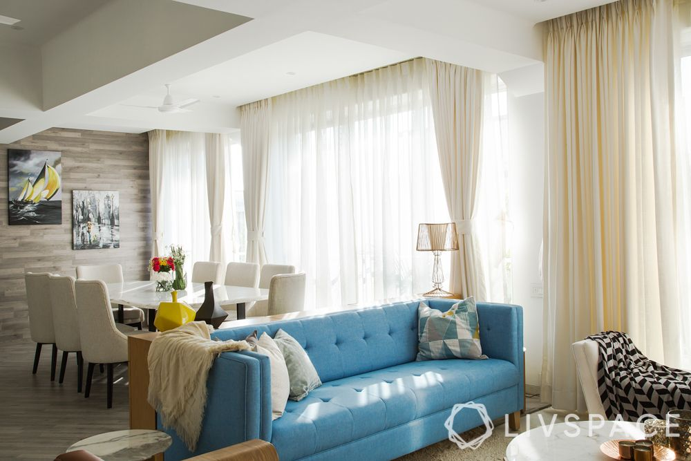 floating furniture-living room-blue sofa-white dining chairs-marble topped fining table