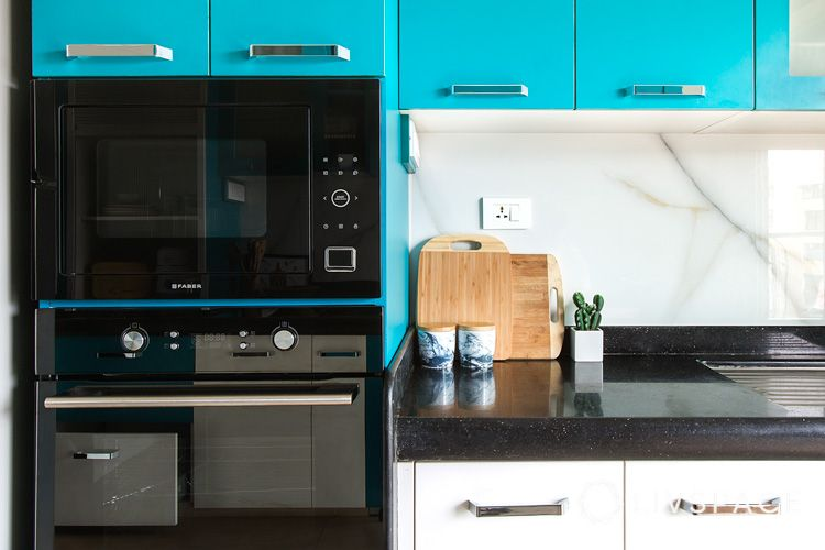 how to clean house-blue cabinets-countertop-cabinets-cutting board
