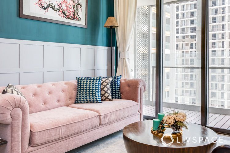 how to clean house-pink sofa-green wall-wall trims-lamp