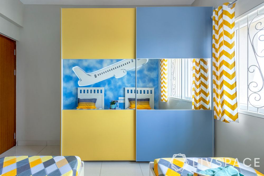 2bhk design-kids room-aeroplane mural-lighting ideas-membrane wardrobe