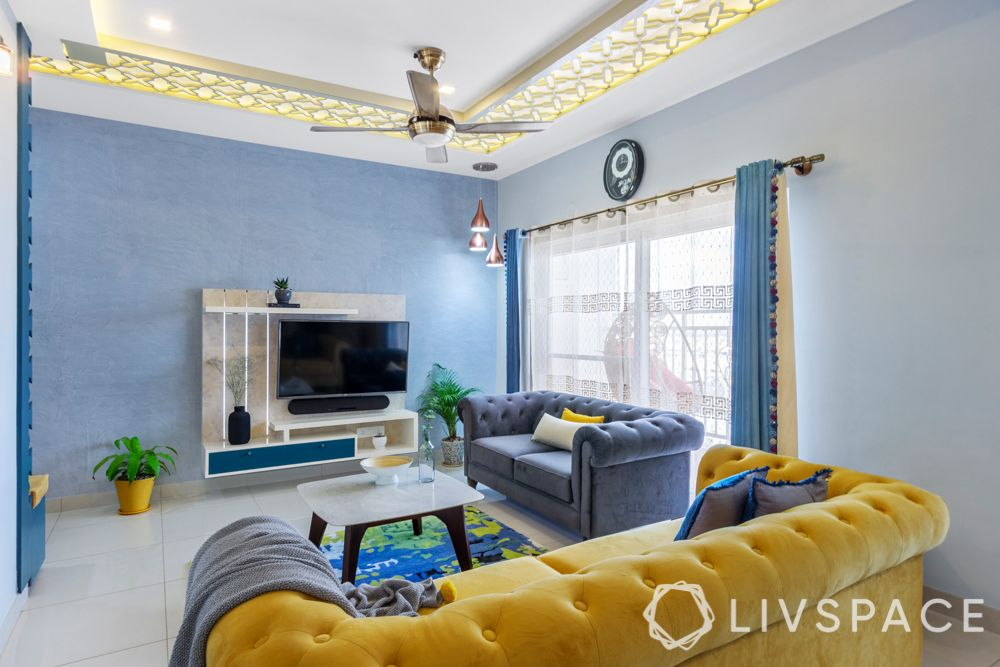 2bhk design-living room-tv unit-suede sofa-false ceiling