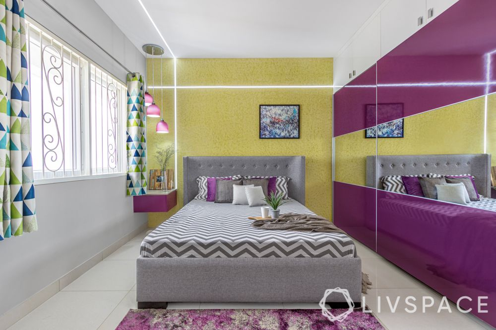 2bhk design-master bedroom-yellow textured paint-high gloss laminate wardrobe-false ceiling design