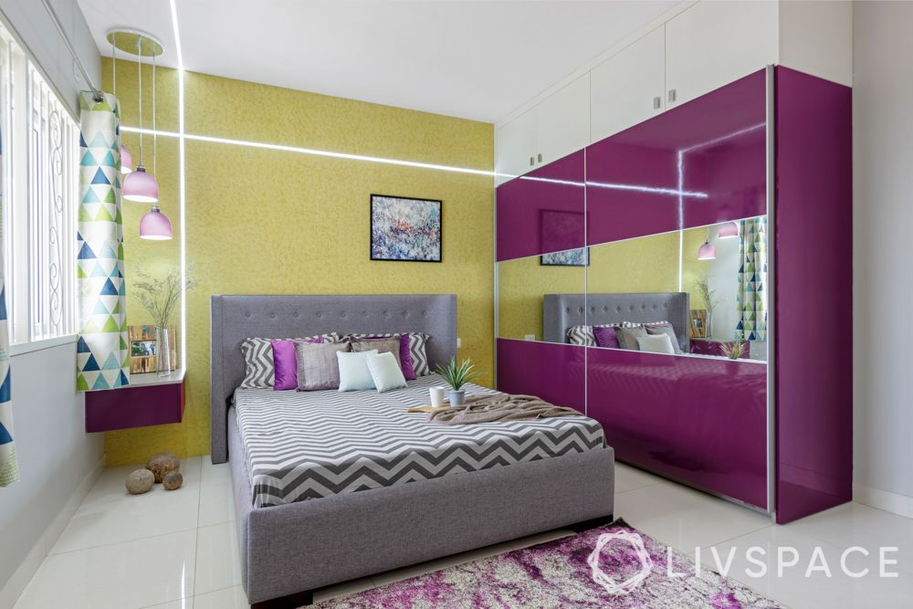 master bedroom-yellow textured paint-high gloss laminate wardrobe-false ceiling design