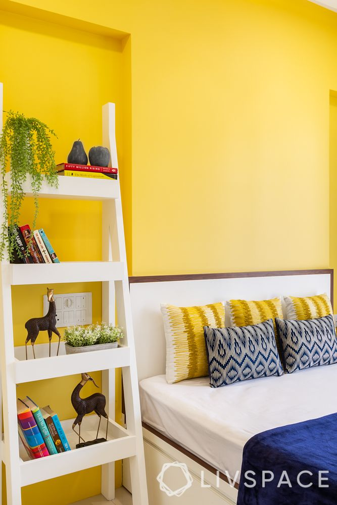 yellow wall paint-white ladder cabinet