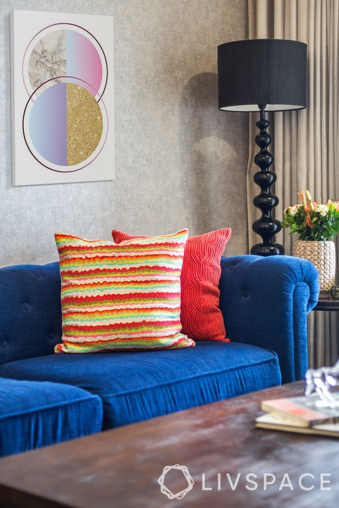 blue couch designs-red cushion designs