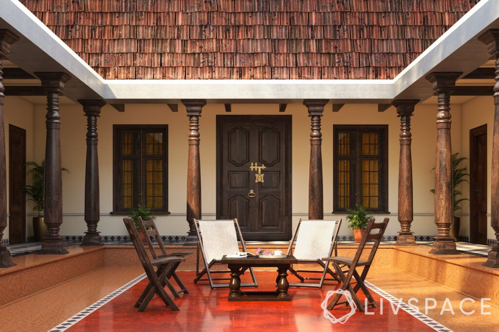 chettinad house-courtyard-tiled roof-pillars-teakwood door-chairs