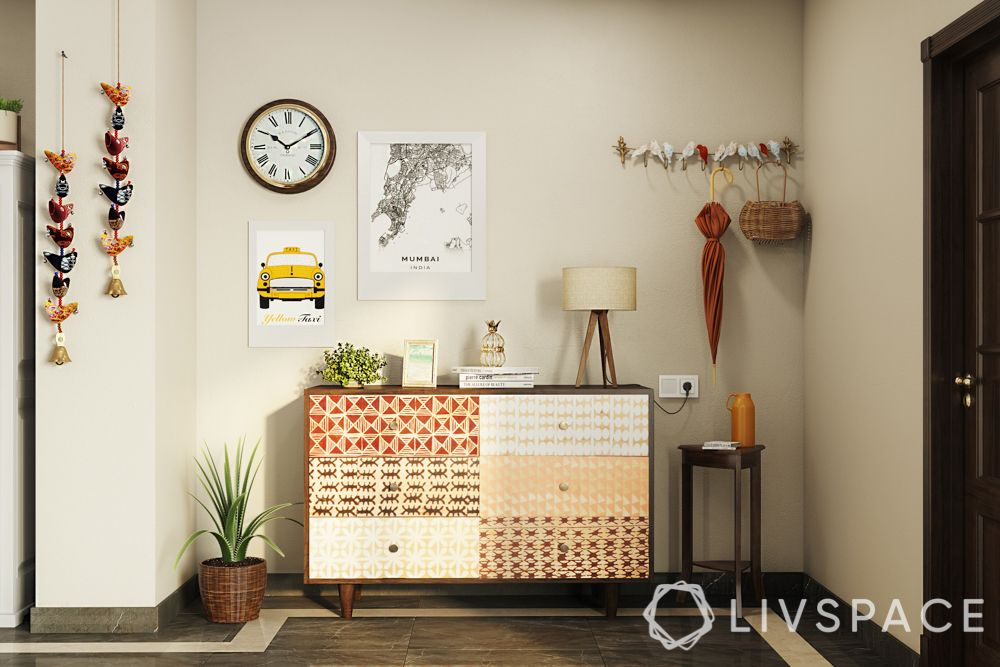 wake up sid-foyer-table lamp-umbrella-chest of drawers-stool-potted plant