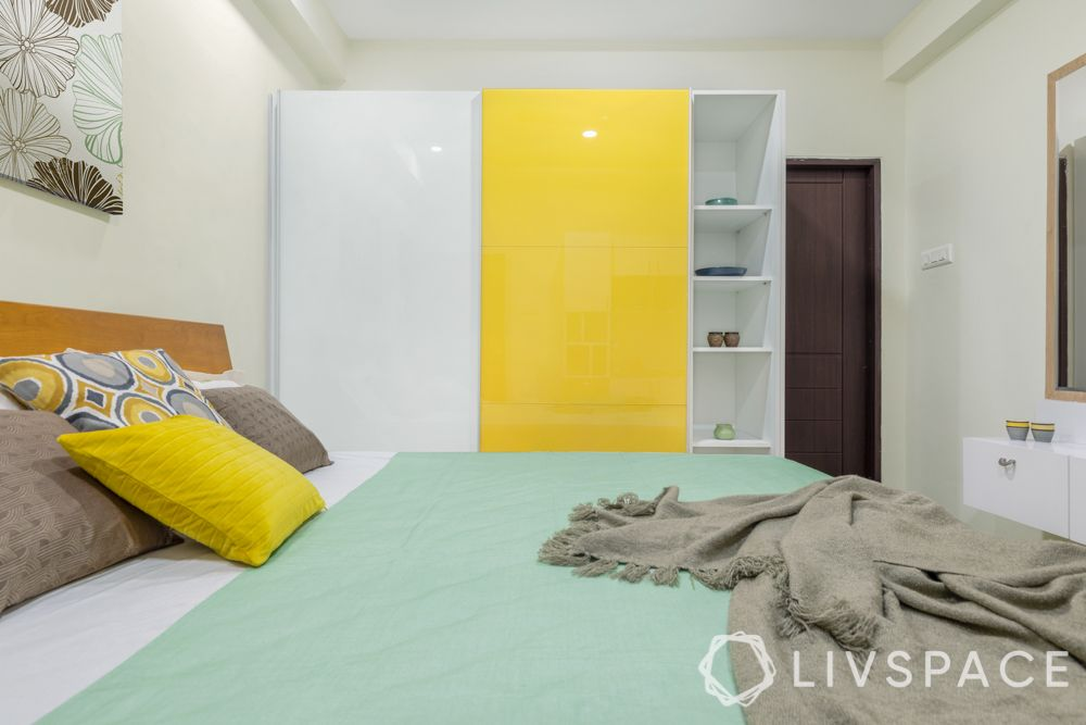 hinged or sliding doors-sliding wardrobe designs-yellow wardrobe designs