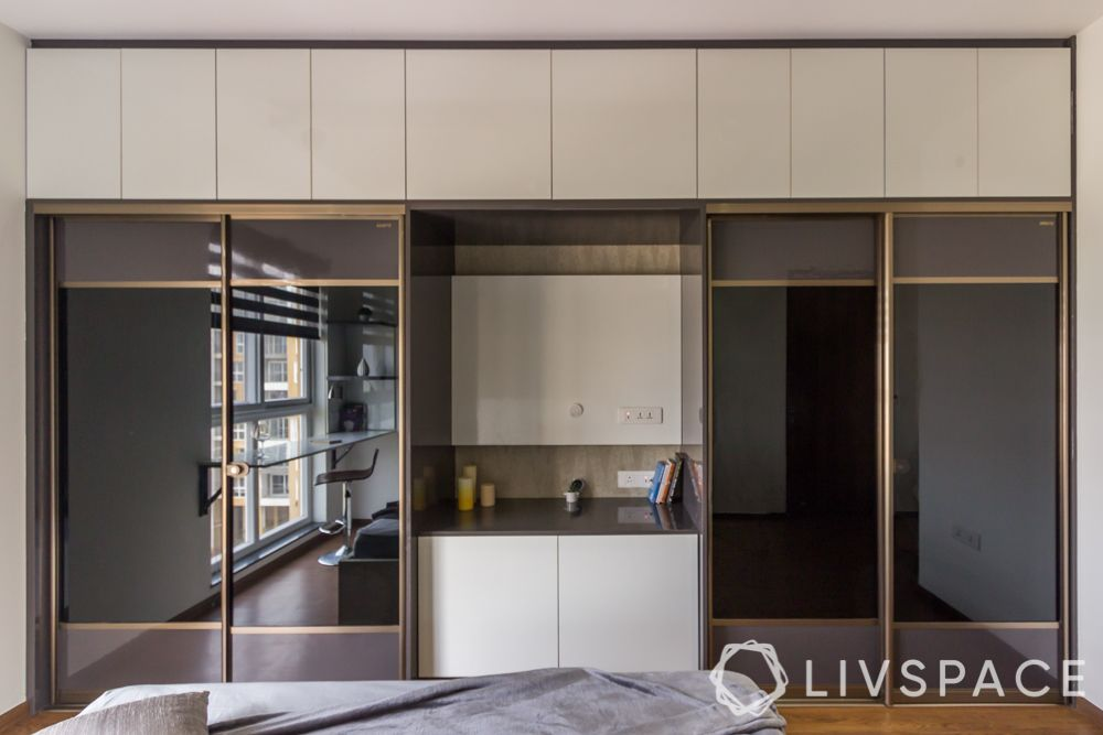 hinged or sliding doors-sliding wardrobe designs-sleek wardrobe designs