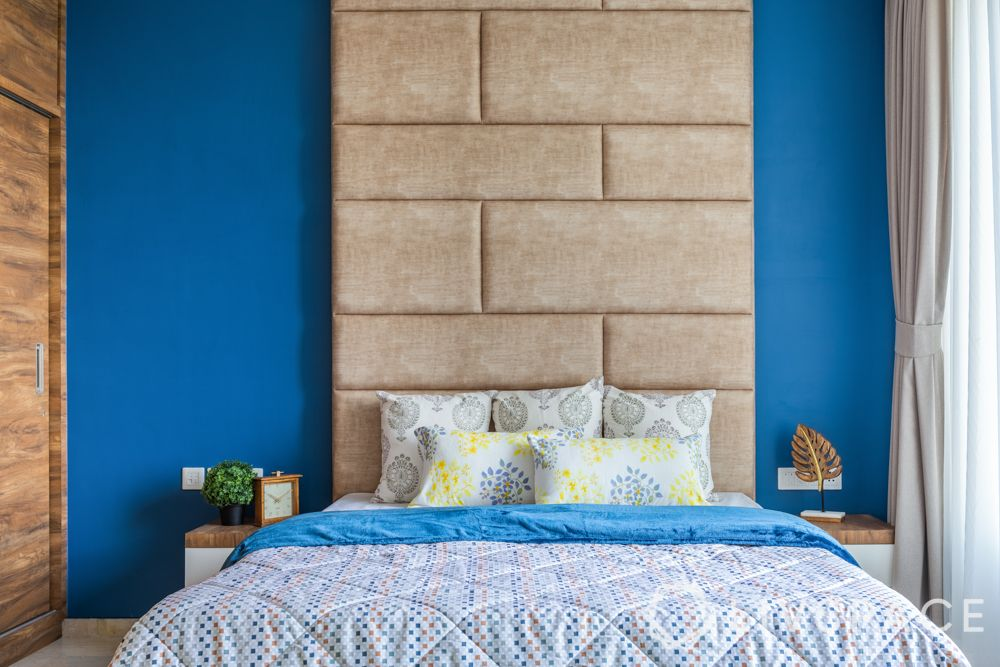 beautiful wall designs-full length headboard-suede bed designs-blue wall-wooden wardrobes